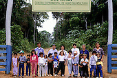 Juruena, Mato Grosso State, Brazil. Pro-Natura silviculture project; schoolchildren at the entrance to the project.