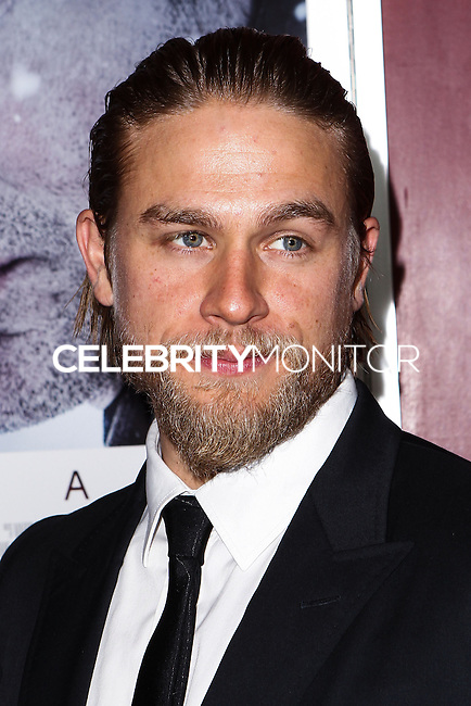 """[(FILE) Actor Charlie Hunnam has been cast as the lead actor in """"Fifty Shades of Grey"""" (2014 Film) to play character Christian Grey. Focus Features and Universal Pictures announced Monday, Sept. 2, 2013 that Hunnam will play the 27-year-old billionaire Christian Grey in the big-screen adaptation of E L James' """"Fifty Shades of Grey"""". Dakota Johnson will play the college student he captivates, Anastasia Steele.] HOLLYWOOD, CA - NOVEMBER 29: Actor Charlie Hunnam arrives at the 'Deadfall' Los Angeles premiere at ArcLight Hollywood on November 29, 2012 in Hollywood, California. (Photo by Xavier Collin/Celebrity Monitor)"""