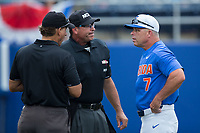 Florida Gators head coach Kevin O'Sullivan (7) listens to an explanation from home plate umpire Billy Haze (center)  and third base umpire Perry Costello during the game against the Wake Forest Demon Deacons in Game Three of the Gainesville Super Regional of the 2017 College World Series at Alfred McKethan Stadium at Perry Field on June 12, 2017 in Gainesville, Florida. The Gators defeated the Demon Deacons 3-0 to advance to the College World Series in Omaha, Nebraska. (Brian Westerholt/Four Seam Images)