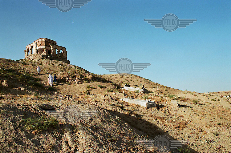 Visitors make their way up Tapa Marajan Hill, the site of the Mausoleum of the ancient King Nadir Shah..