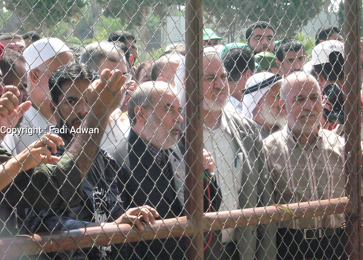"""Acting Chairman of the Legislative Council, Ibrahim Bahr and members of the Palestinian Legislative Council STAGE SIT in the Rafah crossing for the opening of the Rafah crossing July 25,2007.""""photo by Fady Adwan"""""""