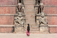 Bhaktapur, Nepal.  Nyatapola Temple, Taumadhi Square.  Guardians line the Stairs to the Nyatapola Temple:  Rajput Wrestler-guardians Jayamel (left) and Phattu (right), Elephants, and others unseen.   The temple survived the April 2015 earthquake virtually undamaged.