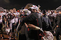 Nov 13, 2010; Charlottesville, VA, USA;  Maryland Terrapins linebacker Alex Wujciak (33) hugs head coach Ralph Friedgen after  the 42-23 win over Virginia Cavaliers at Scott Stadium.  Mandatory Credit: Andrew Shurtleff