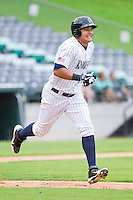 Avisail Garcia (36) of the Charlotte Knights hustles down the first base line against the Lehigh Valley IronPigs at Knights Stadium on August 6, 2013 in Fort Mill, South Carolina.  The IronPigs defeated the Knights 4-1.  (Brian Westerholt/Four Seam Images)