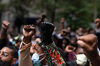 NEW YORK, NEW YORK - JUNE 04: Detail in Protesters fist in march against the death of George Floyd and hold the funeral on June 4, 2020 in Harlem, New York. The white police officer, Derek Chauvin, has been charged with second-degree murder and further charges are pending for the three other officers who participated in the arrest. Floyd's death, the most recent in a series of deaths of black Americans at the hands of the police, has set off days and nights of protests across the country. (Photo by Joana Toro / VIEWpress via Getty Images)