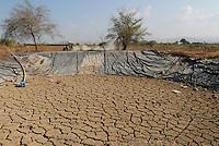 JORDAN, water shortage and agriculture in the Jordan valley , dried water pond / JORDANIEN Wassermangel und Landwirtschaft im Jordan Tal, ausgetrockneter Wasserspeicher fuer Bewaessung