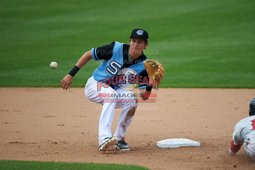 Syracuse Chiefs shortstop Trea Turner (4) waits for a throw as Quintin Berry (17) steals second during a game against the Pawtucket Red Sox on July 6, 2015 at NBT Bank Stadium in Syracuse, New York.  Syracuse defeated Pawtucket 3-2.  (Mike Janes/Four Seam Images)