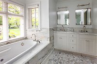 Bright bathroom with marble wainscoting