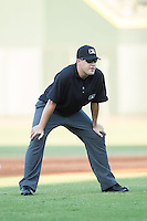 Carolina League umpire Cody Oakes handles the calls on the bases during the game between the Carolina Mudcats and the Winston-Salem Dash at BB&T Ballpark on June 6, 2014 in Winston-Salem, North Carolina.  The Mudcats defeated the Dash 3-1.  (Brian Westerholt/Four Seam Images)