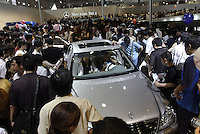 Visitors look at a Mercedes-Benz S350 at the Auto China 2004, Beijing, China..