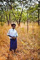 """13 year old Priscilla Mwansa from Chalilo school in Sereje district, on her first safari in Kasanka National Park. """"Other people's view is that the National Park is a hindrance because they would be going into the park and then selling the meat for a profit. [The animals] are beautiful to watch, and they are a symbol that God is great. We shouldn't kill them. I would not accept poachers' meat now. I would now find out where the animal came from and deny that kind of meat."""" Local schools and women's groups are regularly brought into Kasanka, which is unique in the country and unusual in Africa as it is privately managed and owned by a trust. People are able to see animals flourishing in land which was once free reign for poachers. Combined with anti-poaching scouts, the education programme is on the frontline of conservation methods in the park, showing local people wild animals in their natural habitat."""