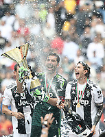 Calcio, Serie A: Juventus - Hellas Verona, Torino, Allianz Stadium, 19 maggio, 2018.<br /> Juventus' Captain and goalkeeper Gianluigi Buffon (r) celebrates with the trophy and his teammate Federico Bernardeschi (r)  during the victory ceremony following the Italian Serie A football match between Juventus and Hellas Verona at Torino's Allianz stadium, 19 May, 2018.<br /> Juventus won their 34th Serie A title (scudetto) and seventh in succession.<br /> Gianluigi Buffon played his last match with Juventus today after 17 years.<br /> UPDATE IMAGES PRESS/Isabella Bonotto