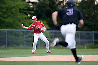 May 10, 2010: Newport High School shortstop Trace Tam Sing makes a throw to second base during a playoff game against Lake Washington High School at Inglemoor High School in Kenmore, Washington.