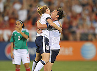 Rachel Buelher (19) of the USWNT celebrates with teammate Abby Wambach (20) her score. The USWNT defeated Mexico 7-0 during an international friendly, at RFK Stadium, Tuesday September 3, 2013.