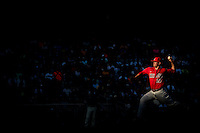 JC Cloney #27 of the Arizona Wildcats pitches during a College World Series Finals game between the Coastal Carolina Chanticleers and Arizona Wildcats at TD Ameritrade Park on June 27, 2016 in Omaha, Nebraska. (Brace Hemmelgarn/Four Seam Images)