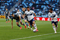 SAINT PAUL, MN - MAY 12: Lucas Cavallini #9 of Vancouver Whitecaps FC brings the ball forward during a game between Vancouver Whitecaps and Minnesota United FC at Allianz Field on May 12, 2021 in Saint Paul, Minnesota.