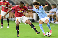 Houston, TX - Thursday July 20, 2017: Antonio Valencia, Leroy Sané during a match between Manchester United and Manchester City in the 2017 International Champions Cup at NRG Stadium.
