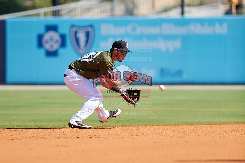 Biloxi Shuckers shortstop Dylan Moore (18) fields a ground ball during a game against the Jacksonville Jumbo Shrimp on May 6, 2018 at MGM Park in Biloxi, Mississippi.  Biloxi defeated Jacksonville 6-5.  (Mike Janes/Four Seam Images)