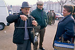 Truffle market Cahors France.  Truffling weighing out truffles for a customer. 1990s