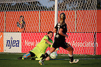 Sky Blue FC goalkeeper Jenni Branam (23) makes a save on McCall Zerboni (7) of the Western New York Flash during a Women's Professional Soccer (WPS) match at Yurcak Field in Piscataway, NJ, on July 30, 2011.