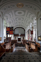 View from the alter down the main aisle of St Michael and All Angels church. The choir stalls were built in 1908 by Temple Moore