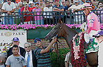 Blind Luck, Garrett Gomez up, wins the Grade II Delaware Handicap at Delaware Park, Stanton, DE, on July 16, 2011. Trainer is Jerry Hollendorfer (in tie and sunglasses), who is also a part owner. (Joan Fairman Kanes/Eclipsesportswire)