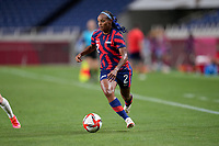 SAITAMA, JAPAN - JULY 24: Crystal Dunn #2 of the United States races along the sideline during a game between New Zealand and USWNT at Saitama Stadium on July 24, 2021 in Saitama, Japan.
