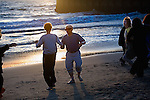 Mature adults dance on the beach at sunset in Playa del Rey, California