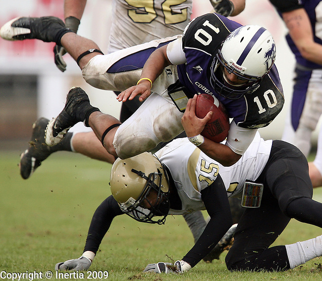 ROME, GA - DECEMBER 19:  Lorenzo Brown #10 of the University of Sioux Falls is upended by Hakim Thomas #15 from Lindenwood University during the second half of the NAIA Championship game Saturday afternoon at Barron Stadium in Rome, GA. (Photo by Dave Eggen/Inertia)