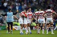 Japan players celebrate at the final whistle. Rugby World Cup Pool B match between South Africa and Japan on September 19, 2015 at the Brighton Community Stadium in Brighton, England. Photo by: Patrick Khachfe / Stewart Communications