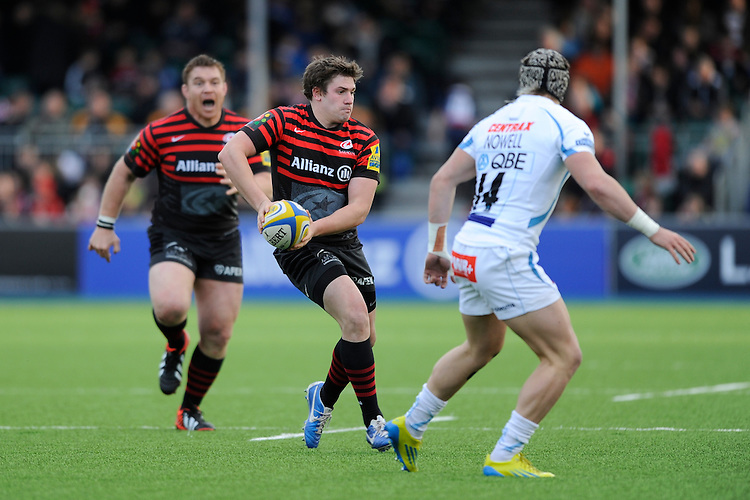 20130216 Copyright onEdition 2013©.Free for editorial use image, please credit: onEdition..Adam Powell of Saracens passes in front of Jack Nowell of Exeter Chiefs as John Smit of Saracens shouts support during thePremiership Rugby match between Saracens and Exeter Chiefs at Allianz Park on Saturday 16th February 2013 (Photo by Rob Munro)..For press contacts contact: Sam Feasey at brandRapport on M: +44 (0)7717 757114 E: SFeasey@brand-rapport.com..If you require a higher resolution image or you have any other onEdition photographic enquiries, please contact onEdition on 0845 900 2 900 or email info@onEdition.com.This image is copyright onEdition 2013©..This image has been supplied by onEdition and must be credited onEdition. The author is asserting his full Moral rights in relation to the publication of this image. Rights for onward transmission of any image or file is not granted or implied. Changing or deleting Copyright information is illegal as specified in the Copyright, Design and Patents Act 1988. If you are in any way unsure of your right to publish this image please contact onEdition on 0845 900 2 900 or email info@onEdition.com