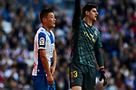 Thibaut Courtois of Real Madrid (R) and Wu Lei of RCD Espanyol (L) during La Liga match between Real Madrid and RCD Espanyol at Santiago Bernabeu Stadium in Madrid, Spain. December 07, 2019. (ALTERPHOTOS/A. Perez Meca)
