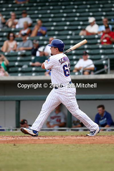 Kyle Schwarber doubles for his first hit with the Mesa Solar Sox in an Arizona Fall League game against the Surprise Saguaros at Sloan Park on October 24, 2016 in Mesa, Arizona. Schwarber, a member of the Chicago Cubs, is recovering from a knee injury that caused him to miss much of the 2016 regular season, but may be ready to return to the Cubs roster in time for the World Series (Bill Mitchell)