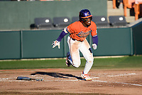Left fielder Kier Meredith (1) of the Clemson Tigers runs toward first in a game against the Stony Brook Seawolves on Friday, February 21, 2020, at Doug Kingsmore Stadium in Clemson, South Carolina. Clemson won, 2-0. (Tom Priddy/Four Seam Images)