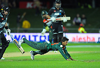 NZ's Daryl Mitchell's shot beats bowler Mahedi Hasan during the second International T20 cricket match between the New Zealand Black Caps and Bangladesh at McLean Park in Napier, New Zealand on Tuesday, 30 March 2021. Photo: Dave Lintott / lintottphoto.co.nz
