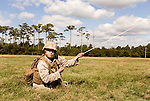 October 22, 2014. Camp LeJeune, North Carolina.<br />  Cpl. Angelique Preston, age 21, of artillery Battery A of the Ground Combat Element Integrated Task Force, pulls on a tent cord as her unit rushes to camouflage their trucks and howitzers.<br />  The Ground Combat Element Integrated Task Force is a battalion level unit created in an effort to assess Marines in a series of physical and medical tests to establish baseline standards as the Corps analyze the best way to possibly integrate female Marines into combat arms occupational specialities, such as infantry personnel, for which they were previously not eligible. The unit will be comprised of approx. 650 Marines in total, with about 400 of those being volunteers, both male and female. <br />  Jeremy M. Lange for the Wall Street Journal<br /> COED