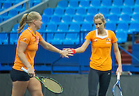 Moskou, Russia, Februari 4, 2016,  Fed Cup Russia-Netherlands,  Dutch team practise doubles   Kiki Bertens and Arantxa Rus (R)<br /> Photo: Tennisimages/Henk Koster