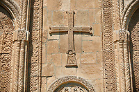 Pictures & images of Nikortsminda ( Nicortsminda ) St Nicholas Georgian Orthodox Cathedral exterior and its Georgian relief sculpture stonework cross decorations, 11th century, Nikortsminda, Racha region of Georgia (country). A UNESCO World Heritage Tentative Site.