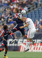 New England Revolution forward Edgaras Jankauskas (10) and Chicago Fire defender C.J. Brown (2) battle for head ball. The New England Revolution out scored the Chicago Fire, 2-1, in Game 1 of the Eastern Conference Semifinal Series at Gillette Stadium on November 1, 2009.