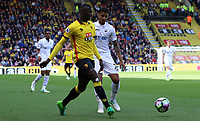 Kyle Naughton of Swansea City challenges Abdoulaye Doucoure of Watford the Premier League match between Watford and Swansea City at Vicarage Road Stadium, Watford, England, UK. Saturday 15 April 2017