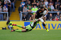 Andrea Masi of Wasps is tackled by George Pisi of Northampton Saints during the Premiership Rugby Round 2 match between Wasps and Northampton Saints at Adams Park on Sunday 14th September 2014 (Photo by Rob Munro)