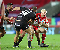 20th November 2020; Totally Wicked Stadium, Saint Helens, Merseyside, England; BetFred Super League Playoff Rugby, Saint Helens Saints v Catalan Dragons; Kyle Amor of St Helens is tackled by Benjamin Jullien of Catalan Dragons