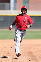 Luis Jimenez #13 of the Los Angeles Angels runs the bases during a Minor League Spring Training Game against the Oakland Athletics at the Los Angeles Angels Spring Training Complex on March 17, 2014 in Tempe, Arizona. (Larry Goren/Four Seam Images)