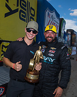 Oct 30, 2016; Las Vegas, NV, USA; NHRA pro stock driver Shane Gray (right) celebrates with son Tanner Gray after winning the Toyota Nationals at The Strip at Las Vegas Motor Speedway. Mandatory Credit: Mark J. Rebilas-USA TODAY Sports