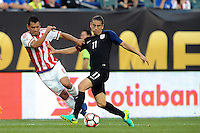 Philadelphia, PA - June 11, 2016: USA midfielder Alejandro Bedoya (11) and Paraguay forward Miguel Samudio (6) during a Copa America Centenario Group A match between United States (USA) and Paraguay (PAR) at Lincoln Financial Field.