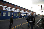Stockport County 2 Rushden & Diamonds 2, 22/01/2006. Edgeley Park, League Two. Stockport County versus Rushden & Diamonds, Coca-Cola Football League Two at Edgeley Park, Stockport. With the teams occupying the bottom two places in the Football league, points were vital in home club's Jim Gannon's first game in charge as manager. The match ended 2-2. Picture shows fans heading past the outside of the main stand before kick-off.<br />  Photo by Colin McPherson.