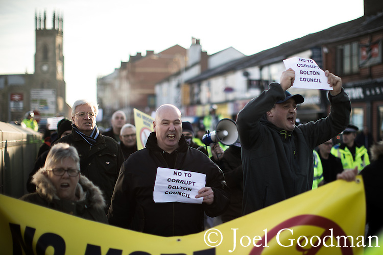 """© Joel Goodman - 07973 332324 . 26/11/2016 . Bolton , UK . Anti-mosque demonstrators march from Bolton station to Victoria Square . Approximately 100 people attend a demonstration against the construction of mosques in Bolton , under the banner """" No More Mosques """" , organised by a coalition of far-right organisations and approximately 150 anti fascists opposing the demonstration , in Victoria Square in Bolton Town Centre . Photo credit : Joel Goodman"""
