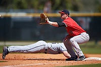 Illinois State Redbirds first baseman Brian Rodemoyer (30) waits for a pickoff attempt throw as Connor Lind (15) dives back to the bag during a game against the Northwestern Wildcats on March 6, 2016 at North Charlotte Regional Park in Port Charlotte, Florida.  Illinois State defeated Northwestern 10-4.  (Mike Janes/Four Seam Images)
