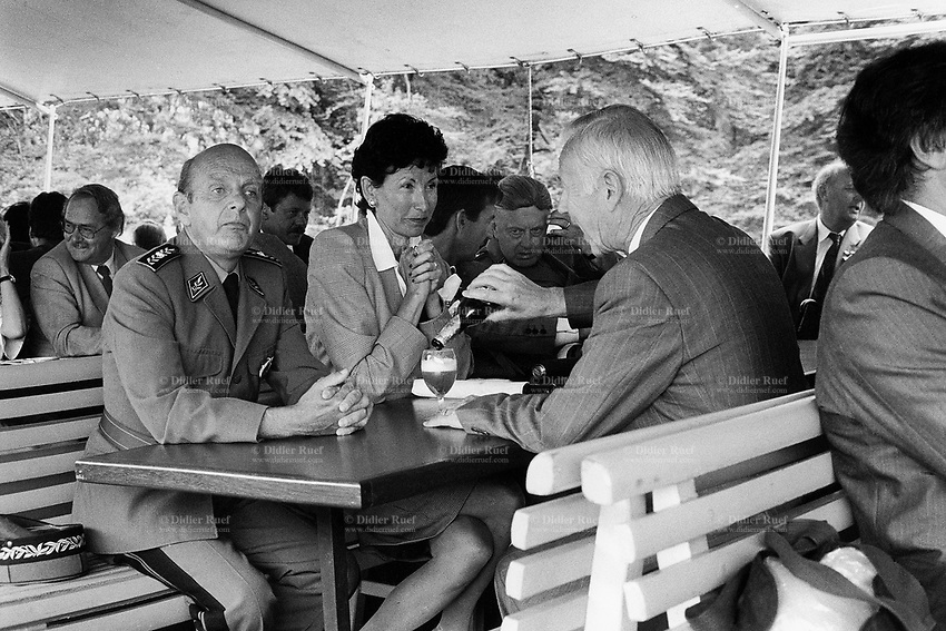 Switzerland. Canton Uri. Boat trip to the Rütli. 1 August 1990. Swiss national holiday. Public holiday. High ranking military officers and politicians. A man drinks a bier. Rütli (or Grütli in French) is a mountain meadow in the Seelisberg municipality of the Swiss canton of Uri. Here the oath of the Rütlischwur is said to have occurred, the legendary turning-point in the pursuit of independence. Every August 1, on the Swiss National Day, the oath is re-enacted to commemorate the forming of the Old Swiss Confederacy. Rütli is the birthplace of the Swiss Confederation. 1.08.1990 © 1990 Didier Ruef