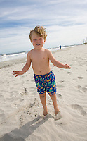 Child playing on the beach, New Jersey